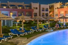 Hurghada, Egypt. November 19 2018 luxury resort with pool at night view. hotel outdoor landscape with pool. Night pool side of. Rich hote stock photography