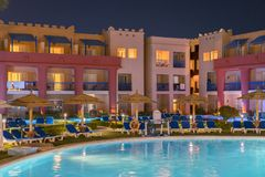 Hurghada, Egypt. November 19 2018 luxury resort with pool at night view. hotel outdoor landscape with pool. Night pool side of. Rich hote royalty free stock image