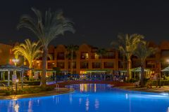 Hurghada, Egypt. November 19 2018 luxury resort with pool at night view. hotel outdoor landscape with pool. Night pool side of. Rich hote royalty free stock photos