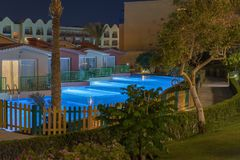 Hurghada, Egypt. November 19 2018 luxury resort with pool at night view. hotel outdoor landscape with pool. Night pool side of. Rich hote royalty free stock photo