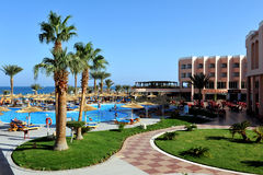 HURGHADA, EGYPT - OCTOBER 14, 2013:Tropical luxury resort hotel on Red Sea beach. Hurghada, Egypt. Royalty Free Stock Photos