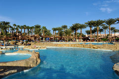 HURGHADA, EGYPT - OCTOBER 14, 2013:Unidentified people swim and sunbathe in the swimming pool at a luxury tropical resort in Egypt Stock Photography
