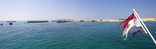 Hurghada sea with an Egyptian flag Royalty Free Stock Photography