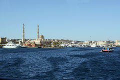 Hurghada sea side view with central muslim mosque and port of modern yachts and boats Royalty Free Stock Photo