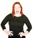 Hurlement de la femme célibataire avec les cheveux rouges Image stock