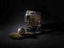 Hurling Equipment From Above. A studio shot of a hurling stick, ball, and helmet. single light illumination Royalty Free Stock Images