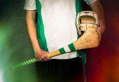 Hurling Player Blank Jersey. Mid section of a hurling player holding a hurling stick and helmet Royalty Free Stock Image