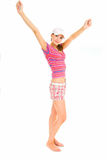 Hurrah vacation. Young woman in summer clothes on white background of studio Royalty Free Stock Images