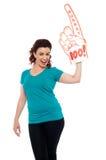 Hurray让庆祝。 快乐的女性风扇 免版税图库摄影