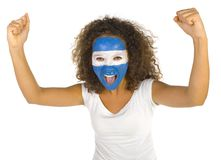 Hurray!. Young screaming Argentinian sport's fan with painted flag on face and with clenched fist. Front view. Looking at camera, white background Stock Photography