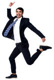 Hurray! We got the contract. Excited young businessman dancing in joy Stock Photo