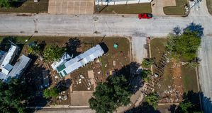 Hurricane Damage in Texas Trailer Park straight down view of destroyed street corner Stock Photos