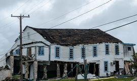 Hurricane damaged property, out of business. Hurricane damaged business, no revenue, no protection , protection from storm, rains, typhoon, flooding, demolished royalty free stock photography