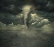 Hurricane in the desert. Photomanipulation of a wild hurricane with dark clouds in a desert Royalty Free Stock Images