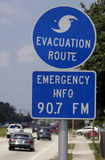 Hurricane evacuation sign. On highway with car traveling in background, Florida, U.S.A Royalty Free Stock Images