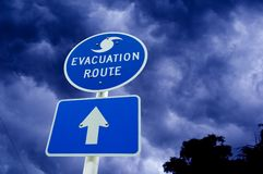Hurricane evacuation sign. With boiling clouds as a background Royalty Free Stock Image
