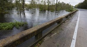 Hurricane Florence floodwaters under a bridge. Bridge near Fayetteville North Carolina with Hurricane Florence water rising royalty free stock photography