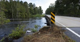 Hurricane Florence water rushing under a bridge. Water rising under a bridge after Hurricane Florence near Fayetteville North Carolina stock photos
