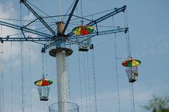 Hurricane flying chair. The hurricane chair is a very popular amusement facility. The hurricane`s flying chair is like a big umbrella or a large umbrella that Stock Photos
