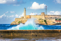 Hurricane in Havana and the castle of El Morro. Hurricane in Havana with a view of the castle of El Morro and big waves crashing against the wall Stock Photo