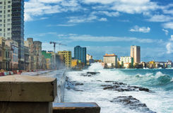 Hurricane in Havana with huge sea waves. Skyline of Havana during a hurricane with big waves crashing against the seaside wall royalty free stock images