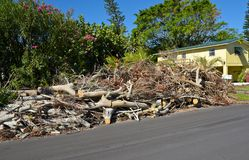 Hurricane Irma Cleanup. ANNA MARIA ISLAND, FL - October 2, 2017:Aftermath of Hurricane Irma on Anna Maria Island, Florida. Piles of Trees, Branches and debris Royalty Free Stock Image