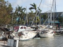 Hurricane Irma Damage. A pile of damaged boats were pushed to land after the entire dock broke from their pilings. The dock was in Coconut Grove Florida. More stock photo
