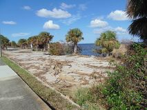 Hurricane Irma Damage Titusville Florida. Taken in Titusville FL on Sept 21, 2017 of damage done by Hurricane Irma.  The dock is missing and parking lot falling Royalty Free Stock Photography