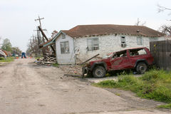 Hurricane Katrina Destruction. A jeep and house damaged by hurricane Katrina Stock Photos