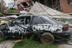 Hurricane Katrina Destruction. A car  destroyed by hurricane Katrina reading Merry Christmas Stock Photo