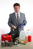 Hurricane Kit - Flashlight. A weatherman with disaster relief supplies, holding up a flashlight & batteries Stock Images
