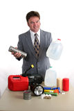 Hurricane Kit - Food & Water. A weatherman showing a hurricane kit and holding up canned food & bottled water Royalty Free Stock Photo