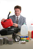 Hurricane Kit - Gas Can. A weatherman displaying disaster supplies and holding a gas can Royalty Free Stock Image