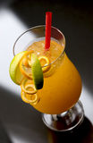 Hurricane Longdrink. Typical Hurricane Longdrink with orange, lime and red straw royalty free stock photography