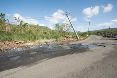 Hurricane Maria Damage in Puerto Rico. Roadside scene in  Puerto Rico after Hurricane Marie showing damage to power lines Royalty Free Stock Photo