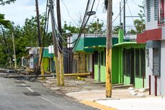 Hurricane Maria Damage in Puerto Rico. Roadside scene in Rincon, Puerto Rico after Hurricane Marie showing damage to businesses and power lines Royalty Free Stock Photography