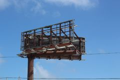 Hurricane Maria damage is seen on a billboard near Carolina Puerto Rico. Hurricane Maria completely stripped this advertising billboard royalty free stock photos