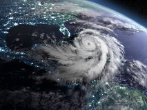 Hurricane Matthew approaching Florida. Earth at night from orbit with city lights and huge hurricane near florida, USA. 3D illustration. Elements of this image Royalty Free Stock Image
