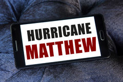Hurricane Matthew danger. Hurricane Matthew which is heading for the US, threatening Florida on mobile phone Stock Photography