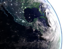 Hurricane Matthew in early morning. City light visible in the early morning when hurricane Matthew approaches Florida in America. 3D illustration Royalty Free Stock Photos