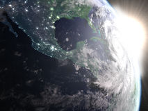 Hurricane Matthew during sunrise from space. Hurricane Matthew seen from space from space approaching Florida in America during sunrise. 3D illustration Royalty Free Stock Image