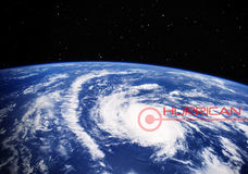 Hurricane on our earth - Elements of this image furnished by NASA. A hurricane - view from outer space with sign and text Stock Photography
