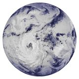 Hurricane over the clouds covered planet Earth stock images