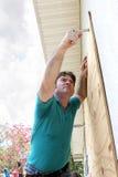 Hurricane Preparation - Attaching Plywood Royalty Free Stock Image