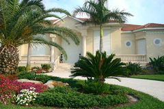Hurricane Proof Home. Beautiful home in tropics with white hurricane shutters and driveway, tropical Stock Images
