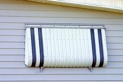 Hurricane Protection Aluminum. Shutter installed on tropical home Royalty Free Stock Photos
