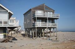 Hurricane Sandy. Long Beach Island, NJ-  Hurricane Sandy washes away the beaches and exposes house pilings.  Taken November 17, 2012 Stock Photo
