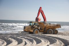 Hurricane Sandy aftermath. Long Beach Island, NJ. Bulldozers moving sand dunes on beach that eroded.  Taken November 18, 2012 Royalty Free Stock Photo