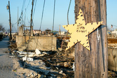Hurricane Sandy burnt debris, Breezy Point, Queens. Sign hangs amidst burnt debris where a neighborhood in Breezy Point, Queens was destroyed by Hurricane Sandy Royalty Free Stock Image