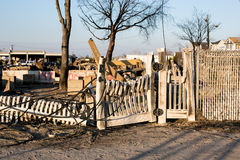 Hurricane Sandy burnt debris, Breezy Point, Queens. Melted white picket fence amidst burnt debris where a neighborhood in Breezy Point, Queens was destroyed by royalty free stock photos